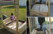 Sand Box couv qui s'ouvre sur le banc et un auvent