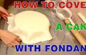 Comment faire pour couvrir un gâteau rond avec la pâte de sucre fondant au