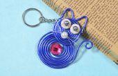 Comment faire joli porte-clés avec fil bleu enveloppé pendentif chat