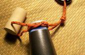 Porter une bouteille avec une poignée de la verseuse noeud