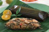 Poulet cuit à la vapeur au citron basilic enveloppé dans des feuilles de palmier bananier