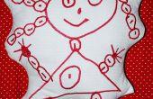 Tourner un enfant dessin dans un doudou brodé