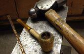 Comment faire pour allumer une pipe avec un marteau.