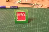 Upcycle un carton de jus dans un cadre de photo.