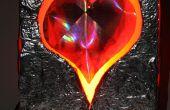 Un coeur embrasé lumineux flottant dans une boîte pour un Cutie
