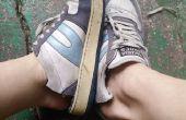 Vers le haut du cycle vieilles chaussures en pantoufles ou à l'extérieur de la chaussures de jardin