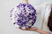 Globe de fleurs à la main