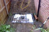 Stockage de l'eau de pluie dans un GRV avec approvisionnement pompé souterrain