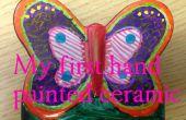 Construire des enfants - main à colorier un papillon en céramique