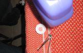 Comment faire pour enlever le bouchon sur une bouteille de nettoyant Swiffer Wet Jet.