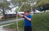 Enfant d'âge préscolaire amicale arc et flèche
