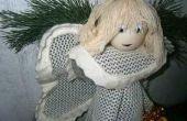 L'ange de Noël : Un accessoire mignon à la main pour décorer votre maison