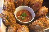 Cuit au four de pilon de poulet avec Sauce piquante maison