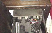 Faire chambre table de chevet tiroir pour sécuriser les armes à feu.