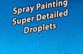 Incroyable détaillée des gouttelettes d'eau de pulvérisation de peinture