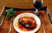 AUBERGINE farcie de fromage Gruyère, les champignons, les poivrons et les oignons & cuit dans une SAUCE rouge vin CLAM