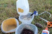 Construire une mangeoire à oiseaux hors un pichet de lait recyclés