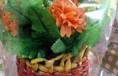 Vase de fleurs du tube du journal