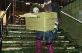 Femme sans tête zomby transportant sa propre tête dans une boîte de
