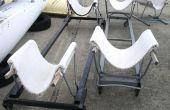 Faire le bateau berceau chariots de restes de tapis, chaises de métal, et/ou paniers