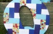 Une lettre de mosaïque patchwork et bouton géante