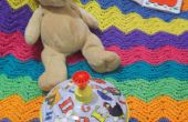 Comment crocheter une Colorful, Wavy Striped Baby Blanket