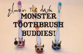 Brillent dans les étreintes de support de brosse à dents monstre des ténèbres !