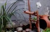Fontaine Shishi-odoshi japonais de tuyau de cuivre