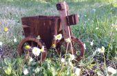 Tricycle avec un seau. (Planteur)