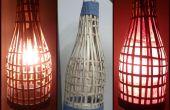 Lanterne bambou à la main. À l'aide de bambou vieux stores.